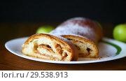 Купить «Sweet homemade strudel with apples in a plate», видеоролик № 29538913, снято 6 декабря 2018 г. (c) Peredniankina / Фотобанк Лори