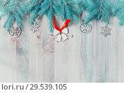 Купить «New Year and Christmas background. Christmas toys, blue fir tree on the wooden background. New Year festive still life», фото № 29539105, снято 8 мая 2017 г. (c) Зезелина Марина / Фотобанк Лори