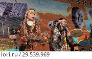 Women and men in national clothing indigenous inhabitants Kamchatka dancing (2018 год). Редакционное видео, видеограф А. А. Пирагис / Фотобанк Лори