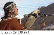 Купить «Woman in national clothing indigenous inhabitants Kamchatka beats tambourine and sings», видеоролик № 29539973, снято 4 ноября 2018 г. (c) А. А. Пирагис / Фотобанк Лори