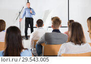 Купить «Male professor delivering speech to students», фото № 29543005, снято 25 июля 2018 г. (c) Яков Филимонов / Фотобанк Лори