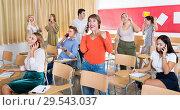 Купить «Student group talking on phones in classroom», фото № 29543037, снято 21 января 2019 г. (c) Яков Филимонов / Фотобанк Лори