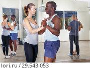 Купить «People exercising waltz movements in pairs», фото № 29543053, снято 30 июля 2018 г. (c) Яков Филимонов / Фотобанк Лори