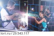 Купить «man and woman with laser guns», фото № 29543117, снято 27 августа 2018 г. (c) Яков Филимонов / Фотобанк Лори