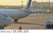 Купить «Official spotting, Utair Aircraft performs taxiing before takeoff», видеоролик № 29545333, снято 1 августа 2018 г. (c) Андрей Радченко / Фотобанк Лори