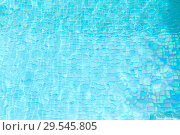 Купить «turquoise water in tiled swimming pool», фото № 29545805, снято 18 февраля 2018 г. (c) Syda Productions / Фотобанк Лори