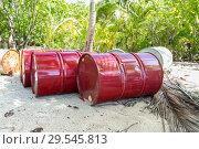 Купить «oil drum barrels on beach in french polynesia», фото № 29545813, снято 21 февраля 2018 г. (c) Syda Productions / Фотобанк Лори