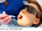 Купить «boy having teeth checkup at dental clinic», фото № 29546037, снято 22 апреля 2018 г. (c) Syda Productions / Фотобанк Лори