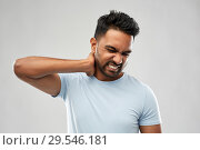Купить «unhealthy indian man suffering from neck pain», фото № 29546181, снято 27 октября 2018 г. (c) Syda Productions / Фотобанк Лори
