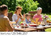 Купить «happy family having dinner or summer garden party», фото № 29546257, снято 9 июля 2017 г. (c) Syda Productions / Фотобанк Лори