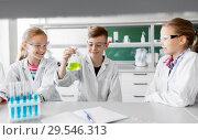 Купить «kids with test tubes studying chemistry at school», фото № 29546313, снято 19 мая 2018 г. (c) Syda Productions / Фотобанк Лори