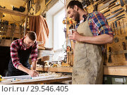 Купить «carpenters with ruler and coffee at workshop», фото № 29546405, снято 14 мая 2016 г. (c) Syda Productions / Фотобанк Лори