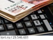 Купить «Российские банкноты и карманный калькулятор. Крупный план», эксклюзивное фото № 29546601, снято 3 декабря 2018 г. (c) Игорь Низов / Фотобанк Лори