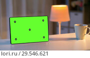 Купить «tablet computer with green screen on table at home», видеоролик № 29546621, снято 10 декабря 2018 г. (c) Syda Productions / Фотобанк Лори