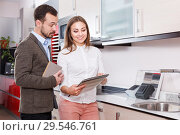 Купить «Female seller consulting male customer in store of furnishing», фото № 29546761, снято 11 апреля 2018 г. (c) Яков Филимонов / Фотобанк Лори