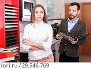Купить «Unhappy woman in store kitchen furnishings», фото № 29546769, снято 11 апреля 2018 г. (c) Яков Филимонов / Фотобанк Лори