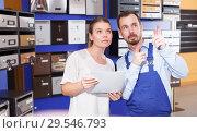 Купить «Male seller helping young client woman choosing new postbox», фото № 29546793, снято 17 апреля 2018 г. (c) Яков Филимонов / Фотобанк Лори