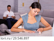 Купить «Woman applying nail polish at home», фото № 29546897, снято 17 июля 2018 г. (c) Яков Филимонов / Фотобанк Лори