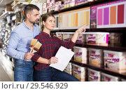 Купить «couple is choosing color for paint with brushes», фото № 29546929, снято 16 февраля 2018 г. (c) Яков Филимонов / Фотобанк Лори