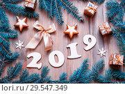 Купить «New Year 2019 festive background with 2019 figures, Christmas toys, blue fir tree branches and snowflakes - 2019 design», фото № 29547349, снято 29 ноября 2016 г. (c) Зезелина Марина / Фотобанк Лори