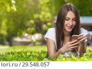 Купить «Attractive Brunette Female in Park Outdoors.», фото № 29548057, снято 16 июля 2017 г. (c) Pavel Biryukov / Фотобанк Лори