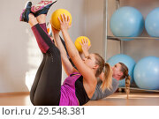 Купить «Young women training in fitness class», фото № 29548381, снято 11 ноября 2018 г. (c) Pavel Biryukov / Фотобанк Лори