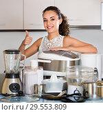 Купить «Housewife with kitchen appliances», фото № 29553809, снято 21 ноября 2019 г. (c) Яков Филимонов / Фотобанк Лори
