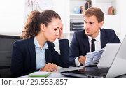 Купить «young man and sad woman coworkers in firm office», фото № 29553857, снято 31 мая 2020 г. (c) Яков Филимонов / Фотобанк Лори