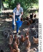 Купить «man farmer strewing bird forage on country yard with chickens», фото № 29553897, снято 22 марта 2019 г. (c) Яков Филимонов / Фотобанк Лори