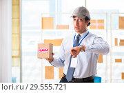 Купить «Male employee working in box delivery relocation service», фото № 29555721, снято 24 июля 2018 г. (c) Elnur / Фотобанк Лори