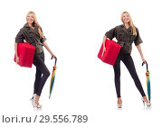 Купить «Young beautiful woman with suitcase and umbrella isolated on whi», фото № 29556789, снято 20 января 2019 г. (c) Elnur / Фотобанк Лори