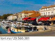 Купить «View of Beaucare town with coast and boats at riverside in France», фото № 29560381, снято 13 октября 2018 г. (c) Яков Филимонов / Фотобанк Лори