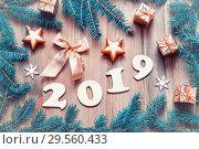 Купить «New Year 2019 festive background with 2019 figures, Christmas toys, blue fir tree branches», фото № 29560433, снято 29 ноября 2016 г. (c) Зезелина Марина / Фотобанк Лори