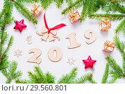 Купить «New Year 2019 background with 2019 figures,Christmas toys, fir branches. Flat lay, top view, New Year 2019 design», фото № 29560801, снято 30 ноября 2016 г. (c) Зезелина Марина / Фотобанк Лори