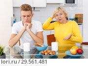 Купить «Sad son and unhappy mother quarrelling», фото № 29561481, снято 25 октября 2018 г. (c) Яков Филимонов / Фотобанк Лори