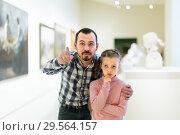 Купить «amazed father and daughter regarding paintings in museum», фото № 29564157, снято 14 декабря 2018 г. (c) Яков Филимонов / Фотобанк Лори