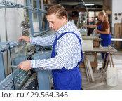 Купить «Man measuring glass with caliper», фото № 29564345, снято 10 сентября 2018 г. (c) Яков Филимонов / Фотобанк Лори