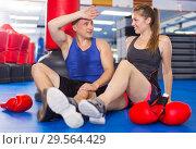 Купить «Woman is talking with trainer on the floor», фото № 29564429, снято 21 августа 2017 г. (c) Яков Филимонов / Фотобанк Лори