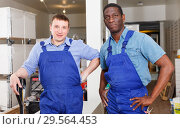 Купить «Two confident construction workers», фото № 29564453, снято 4 мая 2018 г. (c) Яков Филимонов / Фотобанк Лори