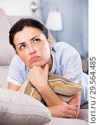 Купить «Portrait of gloomy young woman with pillow», фото № 29564485, снято 2 июня 2017 г. (c) Яков Филимонов / Фотобанк Лори