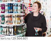 Купить «Woman buying mouline», фото № 29564601, снято 10 мая 2017 г. (c) Яков Филимонов / Фотобанк Лори