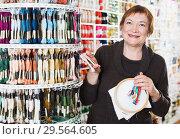 Купить «Woman buying embroidery accessories», фото № 29564605, снято 10 мая 2017 г. (c) Яков Филимонов / Фотобанк Лори