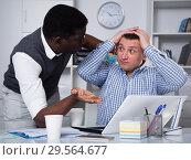 Купить «Upset business partners working in office», фото № 29564677, снято 26 февраля 2018 г. (c) Яков Филимонов / Фотобанк Лори