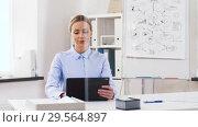 Купить «businesswoman with tablet computer works at office», видеоролик № 29564897, снято 10 декабря 2018 г. (c) Syda Productions / Фотобанк Лори