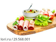 Купить «Pieces of Italian prosciutto on a wooden cutting board», фото № 29568001, снято 12 декабря 2018 г. (c) Татьяна Ляпи / Фотобанк Лори