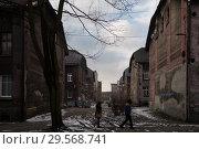 Купить «Poland, Bytom - old, run-down mining settlement in Bobrek district with industrial chimneys», фото № 29568741, снято 28 февраля 2018 г. (c) Caro Photoagency / Фотобанк Лори
