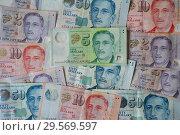 Купить «Singapore, Republic of Singapore, Singapore dollar banknotes in various denominations», фото № 29569597, снято 24 ноября 2018 г. (c) Caro Photoagency / Фотобанк Лори