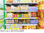 Russia, Samara, November 2018: a variety of packaged products on the shelf in the supermarket. Text in Russian: marshmallow, flax, ginger tea, flax seeds, jelly, hemp seeds, pumpkin seeds, oregano, thyme, ice porridge, golden flax, Редакционное фото, фотограф Акиньшин Владимир / Фотобанк Лори
