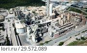 Купить «Aerial view of cement production plant», видеоролик № 29572089, снято 26 августа 2018 г. (c) Яков Филимонов / Фотобанк Лори