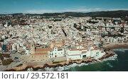 Купить «Video of aerial view of mediterranean resort town Sitges, Spain», видеоролик № 29572181, снято 27 апреля 2018 г. (c) Яков Филимонов / Фотобанк Лори